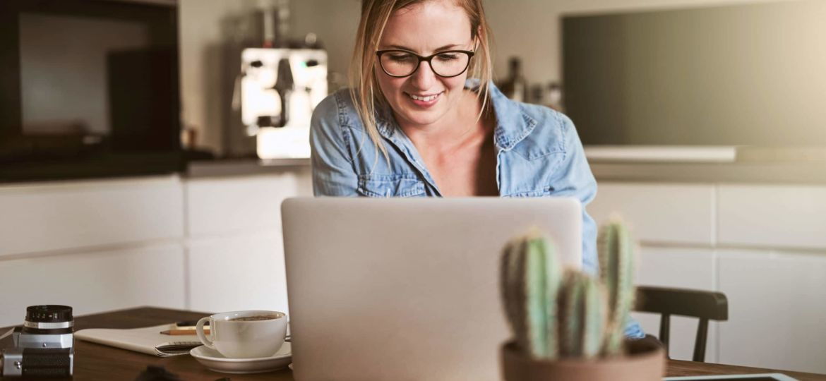 Entrepreneur working on her small business at her kitchen table